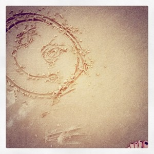 smiley-face-drawn-in-the-sand