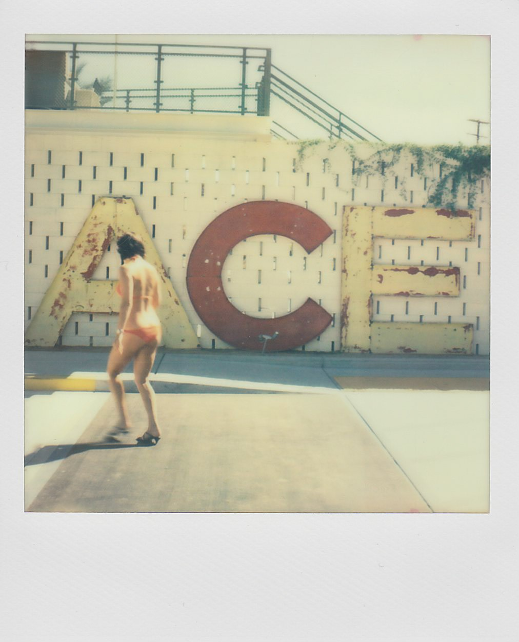 ACE_HOTEL_SIGN_PALM_SPRINGS_WOMAN_SWIMSUIT_POLAROID