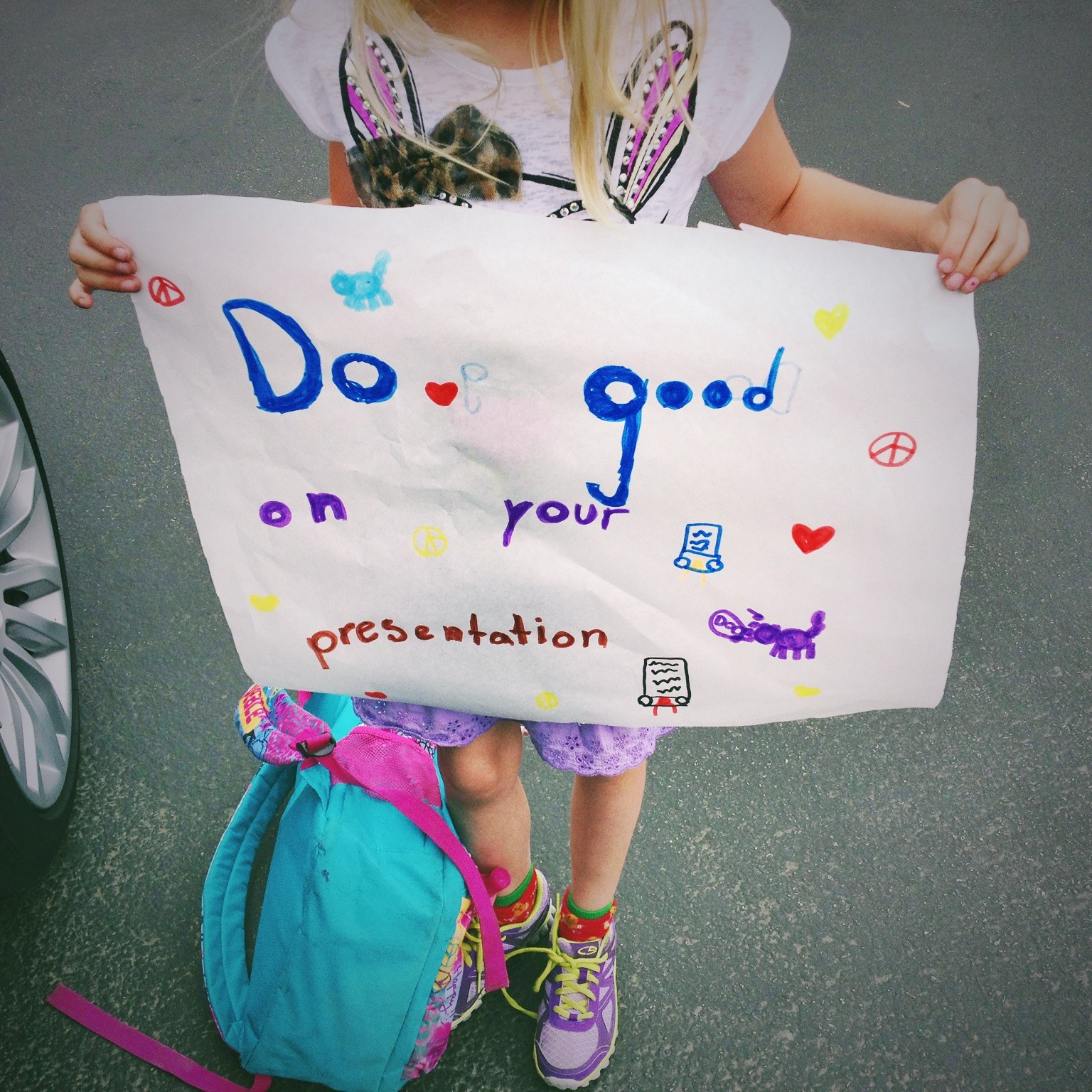 daughter-makes-good-luck-sign-for-mom